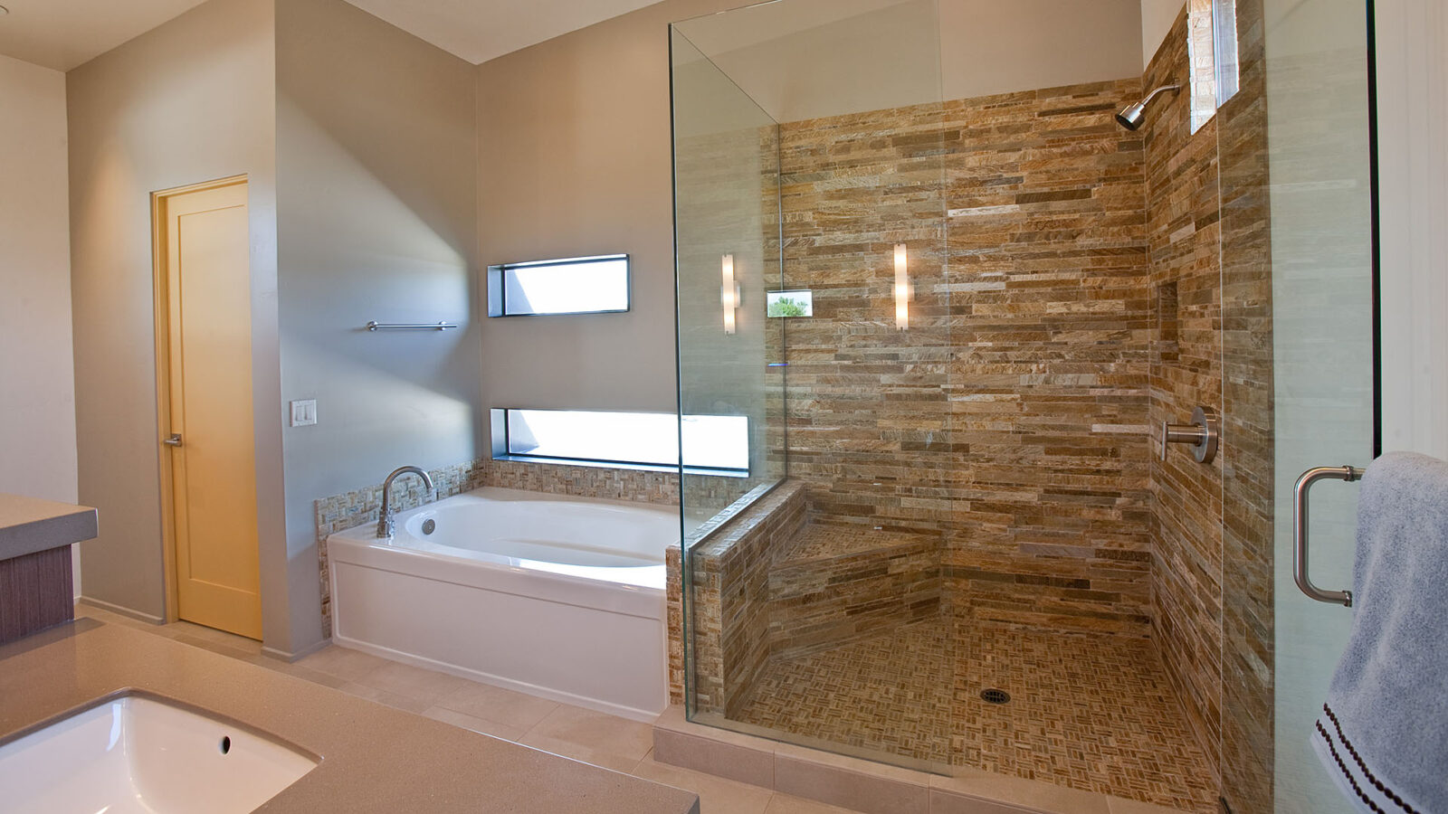 An Arcadian Mode designed bathroom with a shower and tub