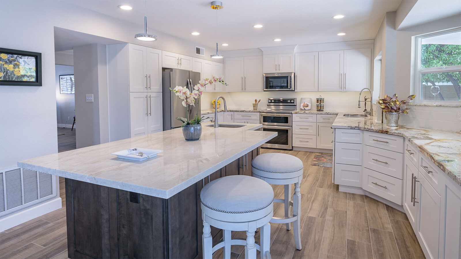 A white kitchen with marbled panels