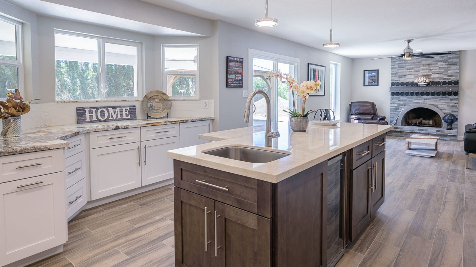 A kitchen island with a white marble finished surface