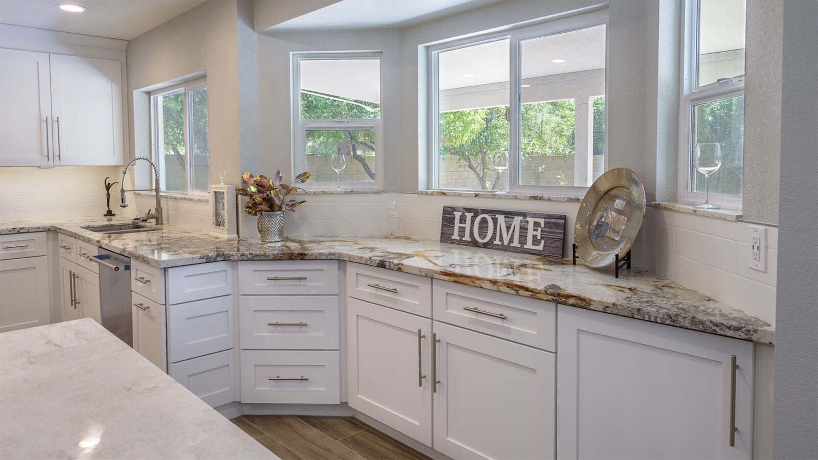 A kitchen with white raised panels