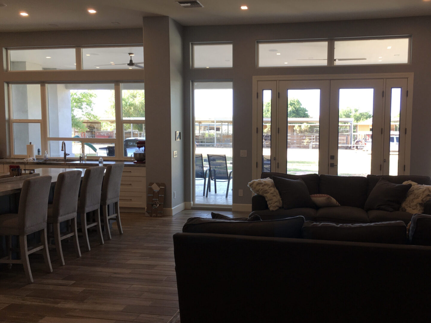 Large glass doors overlooking the outside of a house
